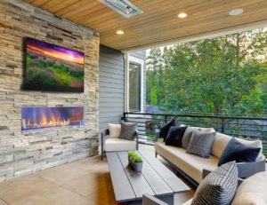 Seura outdoor television above outdoor fireplace on luxury patio